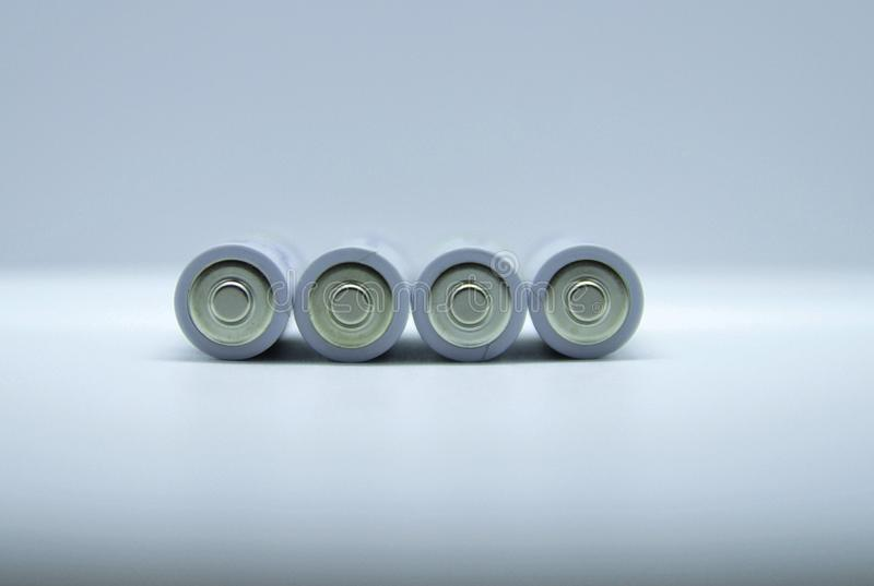Four4silver AA batteries isolated on white royalty free stock photos