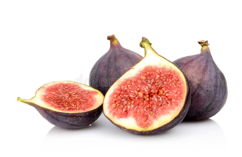 Four sliced figs isolated on white background. Four sliced figs lengthwise in half, isolated on white background stock photos