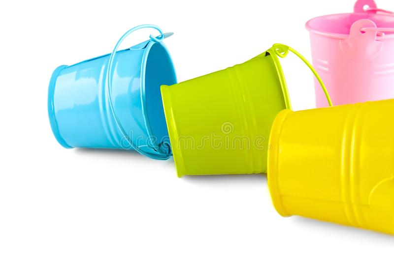 Four small colorful buckets. Isolated on white background.  royalty free stock photography