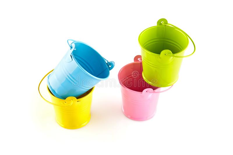Four small colorful buckets. Isolated on white background.  stock photography