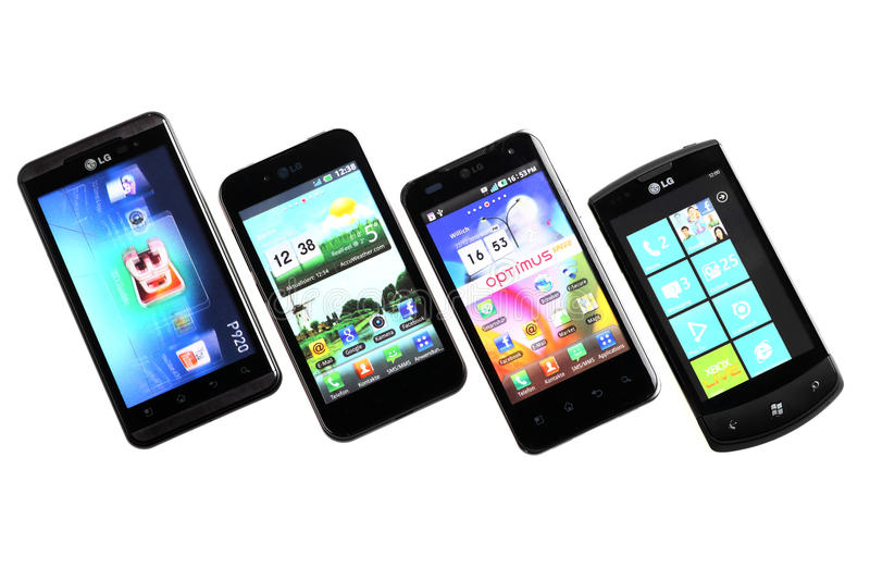 Four smart-phones. Bucharest, Romania - October 29, 2012: Four smartphones displayed in line, isolated on white, using various operating systems, like Windows stock images