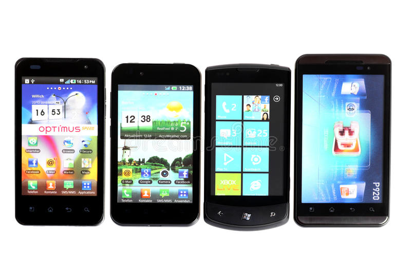 Four smartphones. Bucharest, Romania - October 29, 2012: Four smartphones displayed in line, isolated on white, using various operating systems, like Windows stock photos