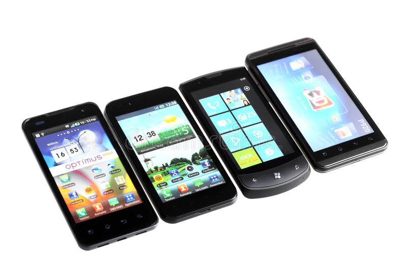 Four smartphones. Bucharest, Romania - October 29, 2012: Four smartphones displayed in line, isolated on white, using various operating systems, like Windows royalty free stock images