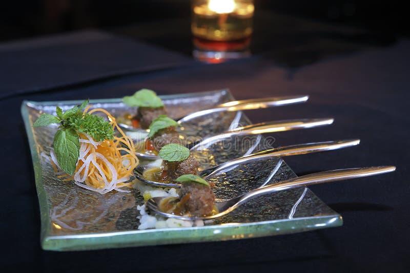 Four Spoons Of Meatball stock photos