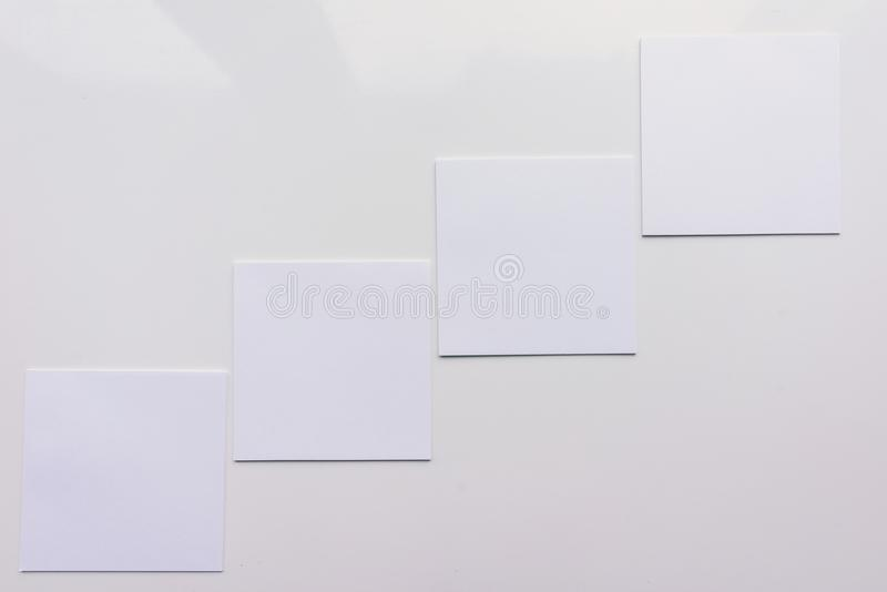Four square sheet on a white background. Top view. Close-up stock illustration