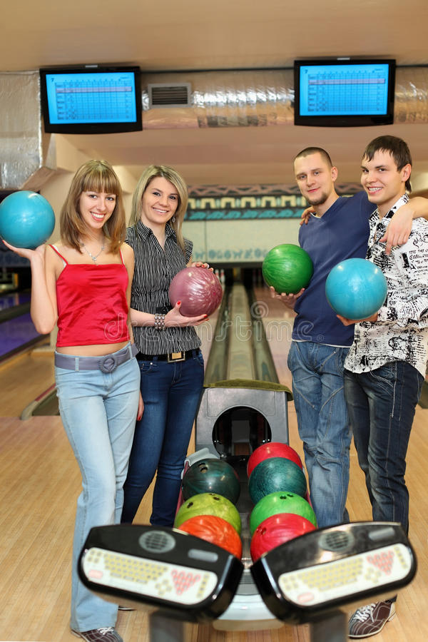 Download Four Students Stand Near Tenpin Bowling With Balls Stock Image - Image: 20698835