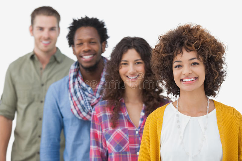Four stylish friends smiling at camera stock images