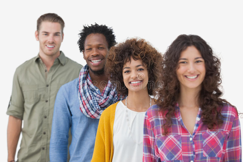 Four stylish friends standing in a row royalty free stock photography