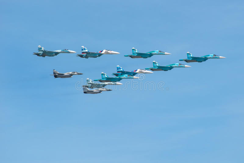 Four Su-34, four Su-27 and two MiG-29 royalty free stock photos