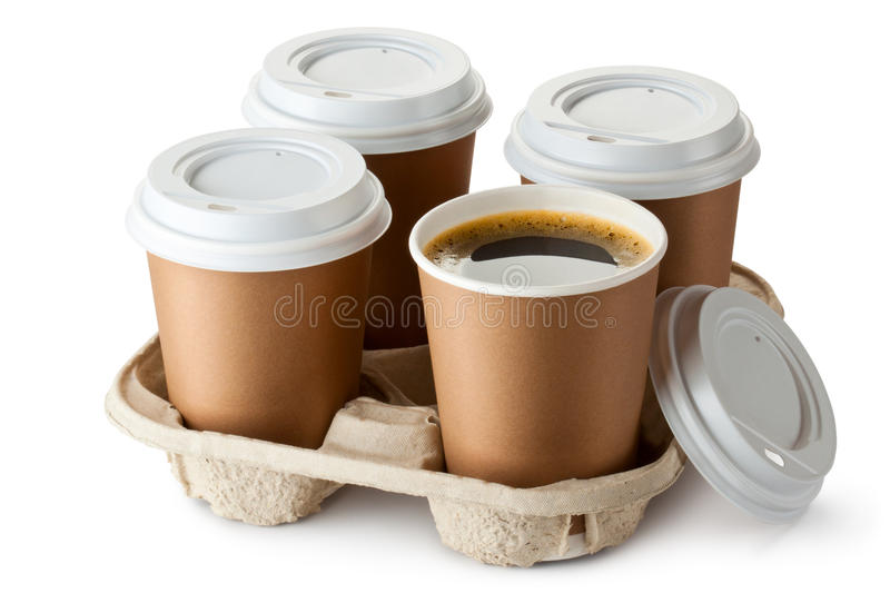 Four take-out coffee in holder royalty free stock photos