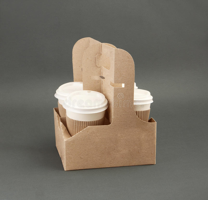 Four take-out coffee in holder stock photography
