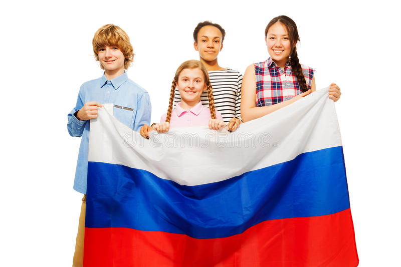Four teenage kids with flag of Russian Federation. Group of four smiling teenage kids with flag of Russian Federation, on white stock photos