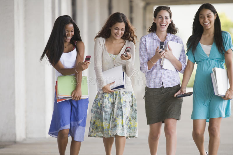 four teenage together walking стоковые изображения rf