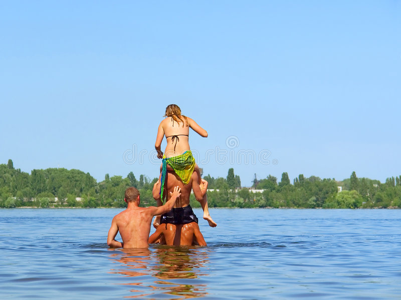 Download Four Teens - Triple Piggyback Stock Photo - Image of beautiful, many: 3095572