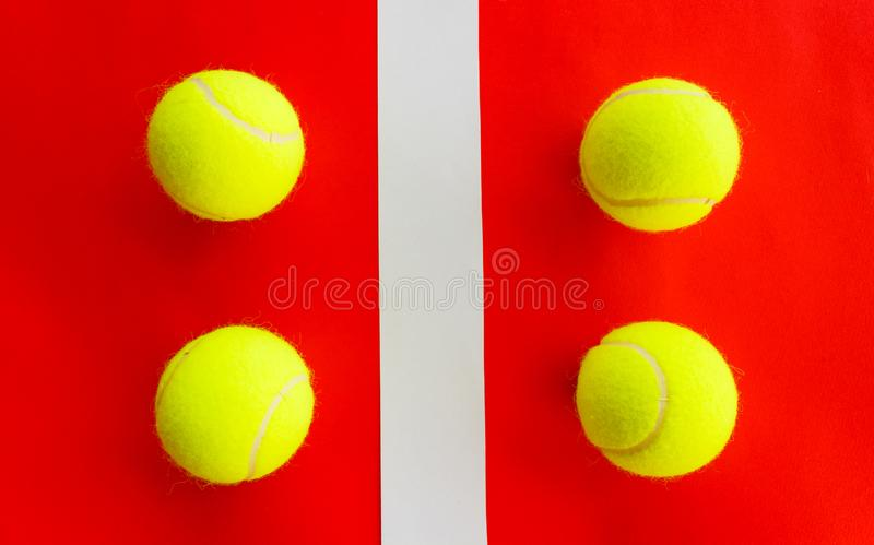 Four tennis balls divided by a field line stock photos