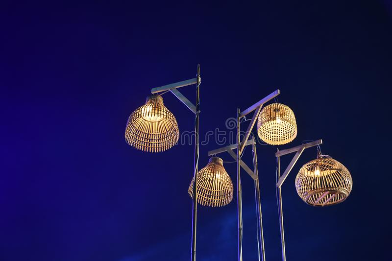 Four Thai ancient wooden lamp and blue light with night sky background stock images