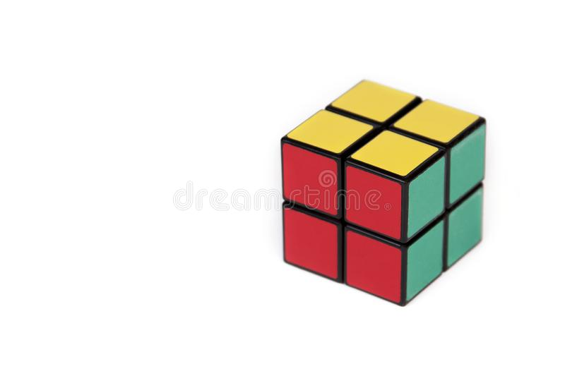 Four tiles cube, simple puzzle isolated on white background royalty free stock photo