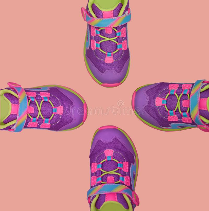 Four of tips of kid shoes  on pastel background royalty free stock photography