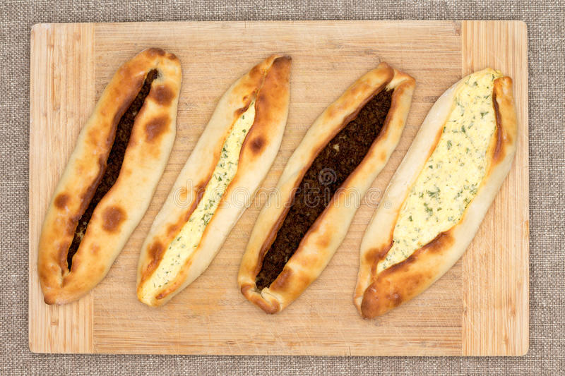 Four traditional Turkish pide with meat and cheese stock photography