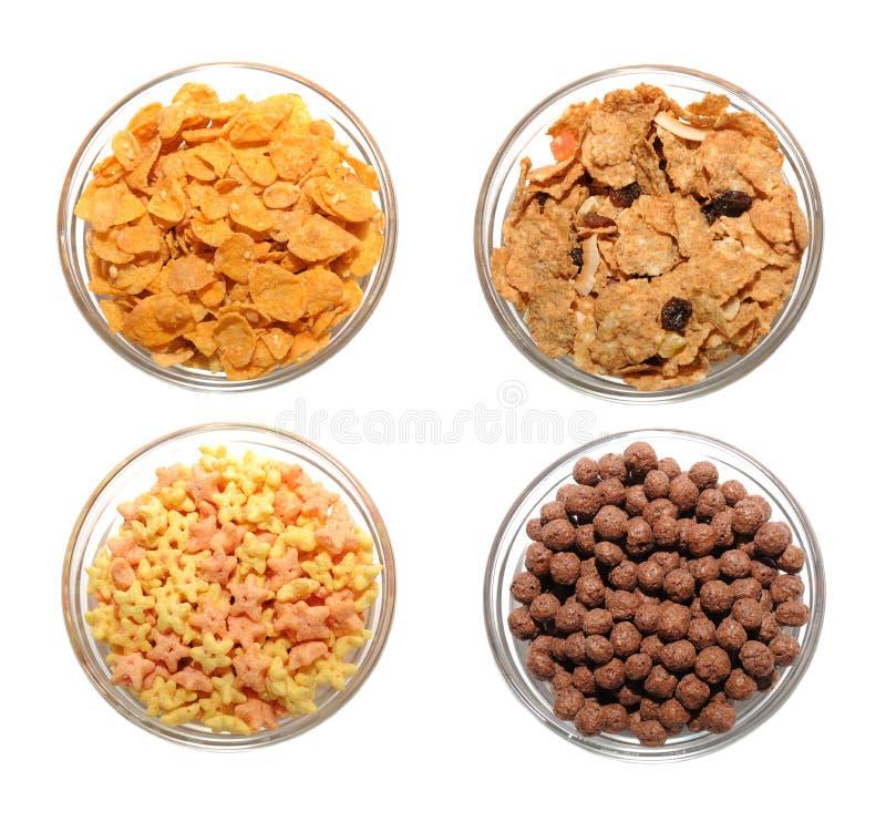 Four transparent bowls with corn flakes stock photos