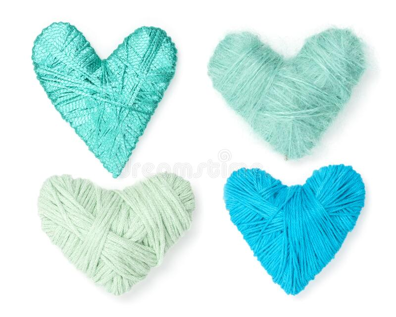 Four turquoise, green, blue wool hearts stock images