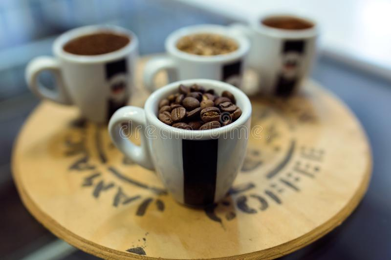 Four types of coffee beans in cups in an organic store. royalty free stock photo