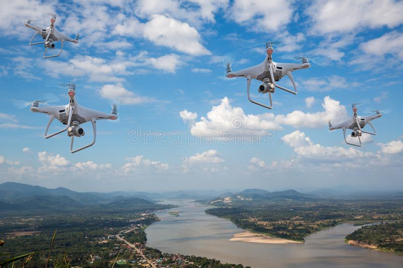 Four uav drone copter flying with digital camera.Drone with high resolution digital camera.Flying camera take a photo and video. royalty free stock images