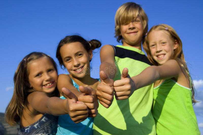 Four very positive kids royalty free stock photo