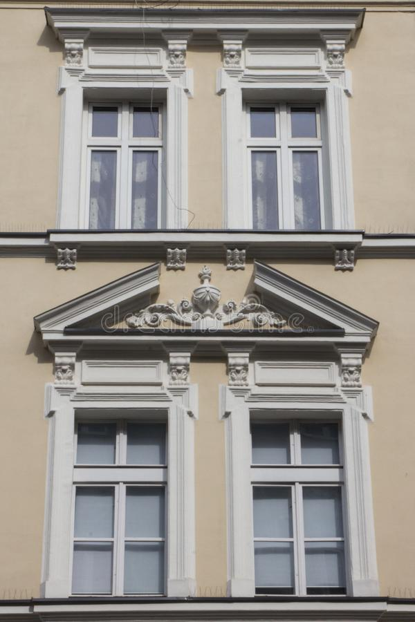 Four vintage design windows on the facade of the old house.  stock photos