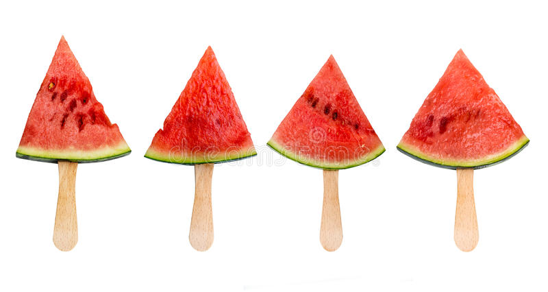 Four watermelon slice popsicles isolated on white, fresh summer fruit concept royalty free stock photo