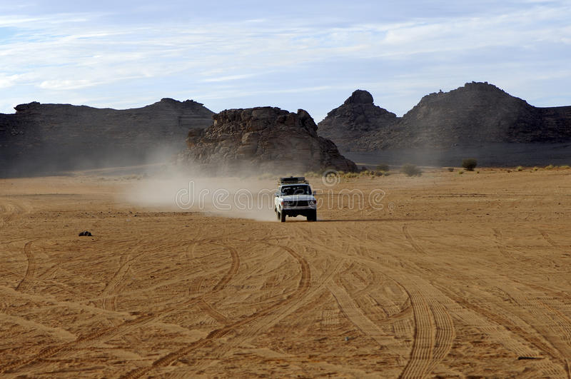 Download Four-wheel Drive Jeep On A Desert Road Royalty Free Stock Photo - Image: 11823225