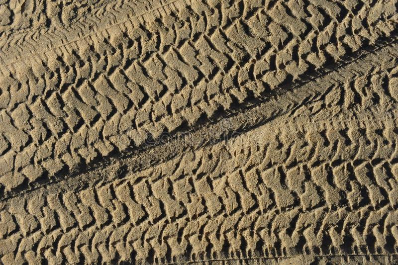 Four wheel drive tracks in sand textured background stock photo