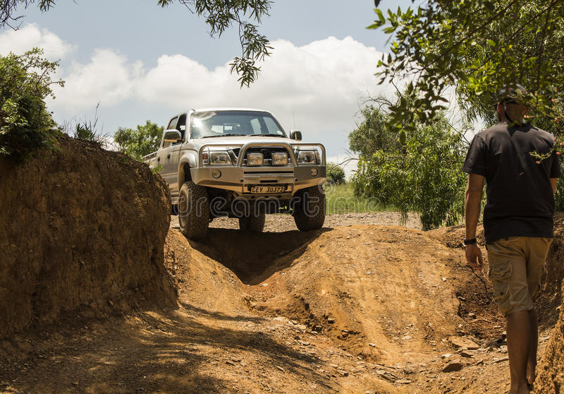 Four-wheel drive vehicle Toyota Hilux is doing off-road. stock photography