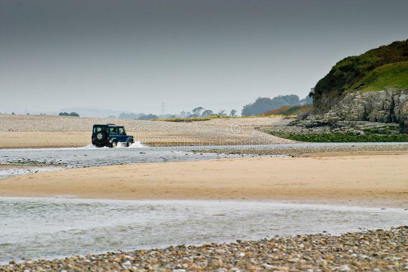 Download A Four-wheel-drive In Water Between The Sand Dunes Stock Image - Image: 7511067