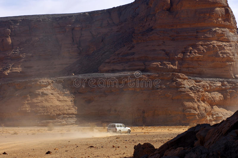 Four-wheel vehicle in a desert stock photo