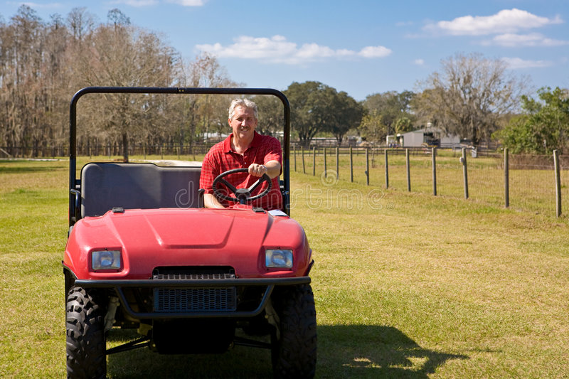 Four Wheeling on the Farm royalty free stock images