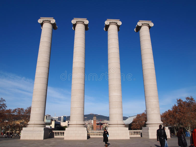 Four white columns, Montjuic, Barcelona. Barcelona, Spain - December 2011 : Four white columns in Montjuic. The columns, symbolizing the four stripes of the royalty free stock photography