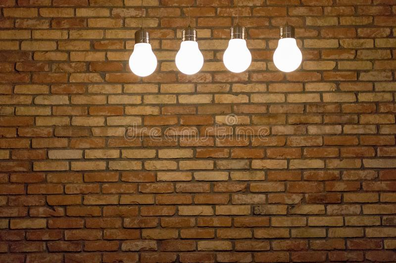 Download four white lamps on brick wall background with copy space grunge texture loft