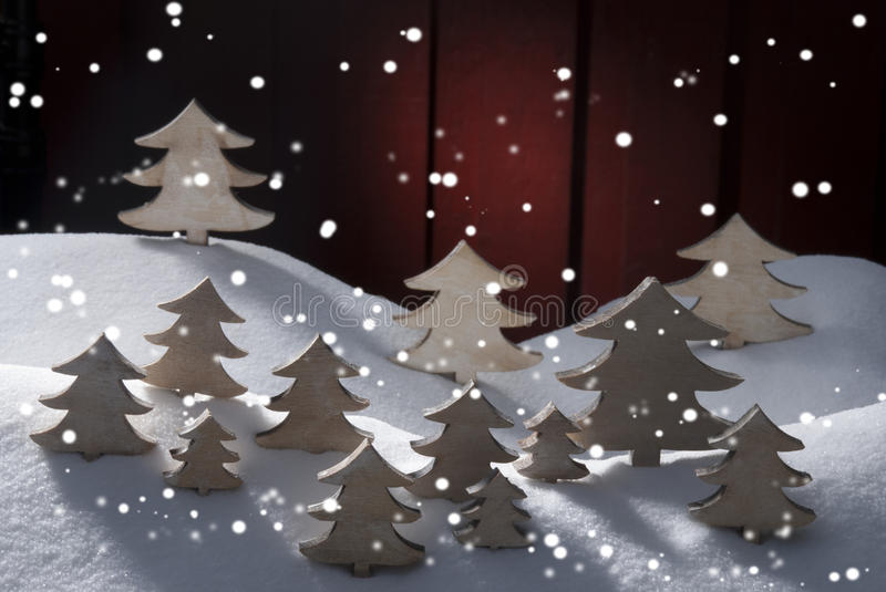 Four White Wooden Christmas Trees, Snow. Many White Christmas Trees On Snow With Snowflakes. White Snowy Scenery As Christmas Decoration. Christmas Time Or royalty free stock photography