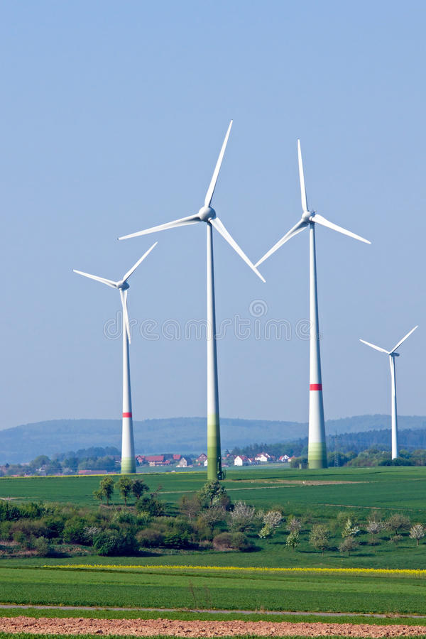 Download Four Windwheels In The Fields Stock Photo - Image of environmentally, nature: 23875848