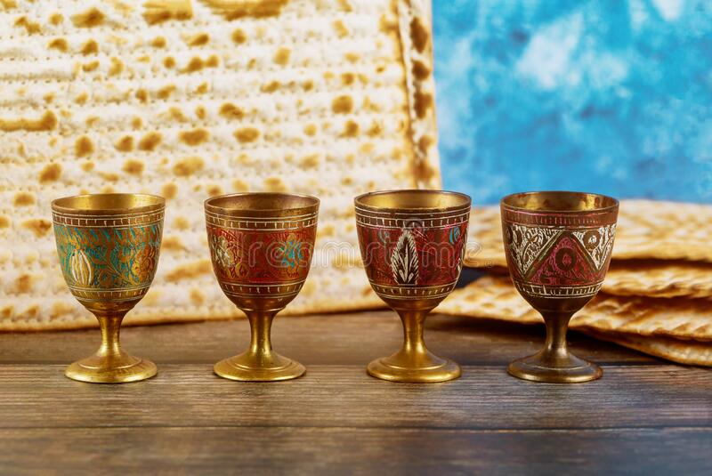 Four wine cups with matzah. Jewish holidays Passover stock images