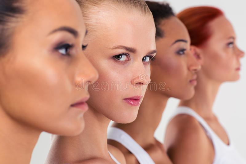 Four woman standing in a row stock image