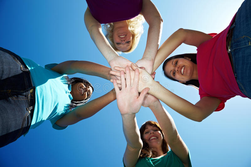 Download Four Women Stacking Their Hands Stock Photo - Image: 14862082