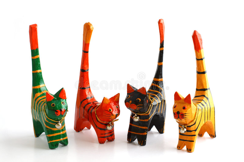 Four wooden cats. On white stock images