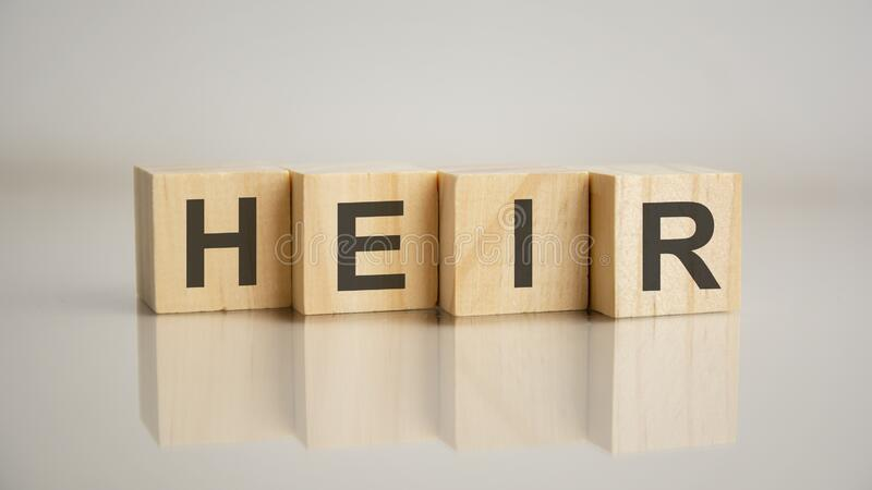 Four Wooden Cubes with Letters Heir. Business Marketing ...