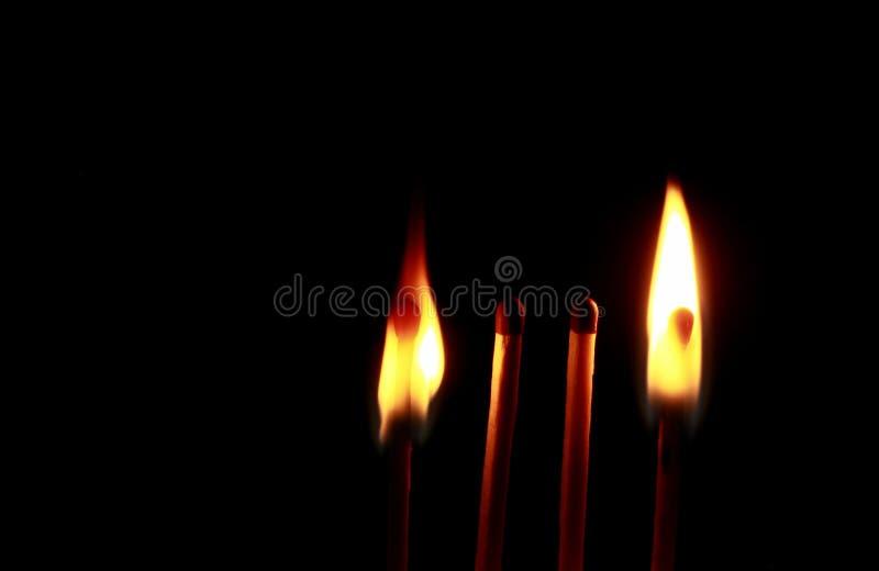 Four wooden matches stock photos