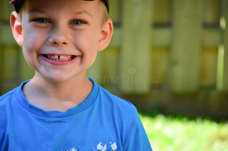 Four year old caucasian boy close up face. Blue eyed boy outside. close up of 4 year old face. Caucasian boy. four year old boy. healthy boy. smiling with teeth stock photo