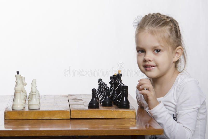 Four-year-old Girl Learns To Play Chess Stock Photos