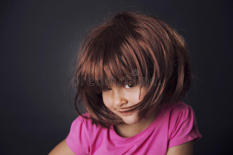 Four years girl and wig stock photography