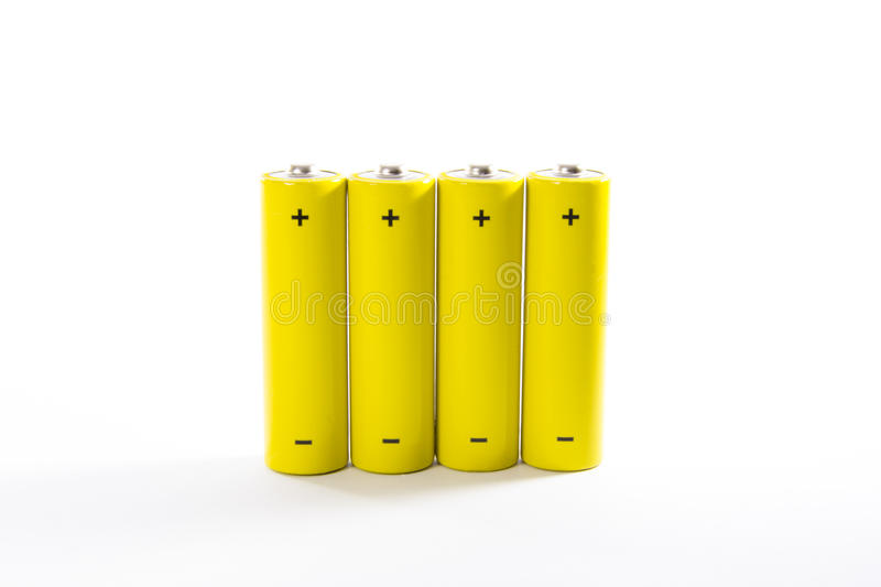 Four yellow batteries royalty free stock image